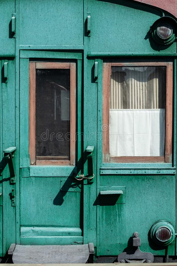 Old wooden railway wagon of green color.  royalty free stock image