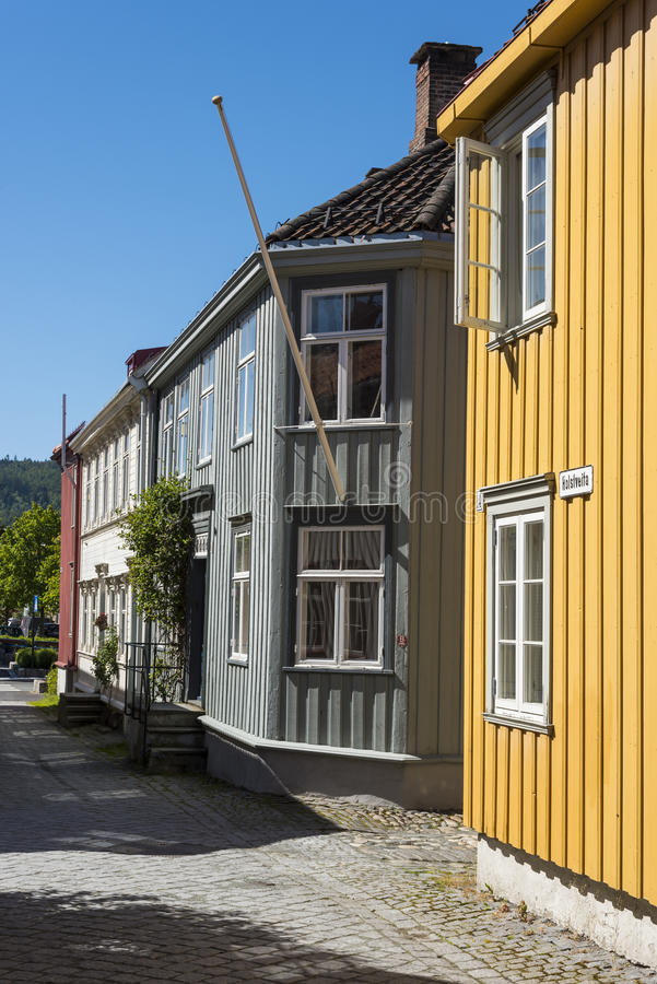 Old wooden residential houses Trondheim. Old wooden residential houses at a narrow stone paved street in Trondheim, Norway stock image