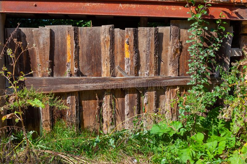 The texture of wooden boards. Old wooden rustic fence. The texture of wooden boards royalty free stock photo
