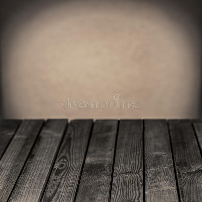 Old wooden rustic table in a grunge room royalty free stock images