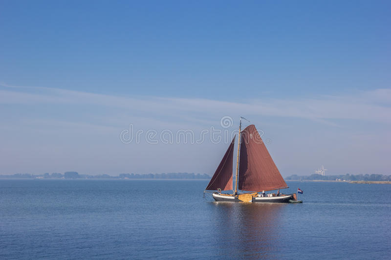 Old wooden sailing boat on the Ijsselmeer near Hoorn stock images