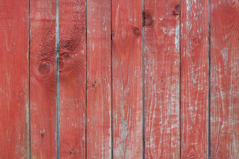 Old wooden scratched background with vertical lines and knots with old red paint royalty free stock photos