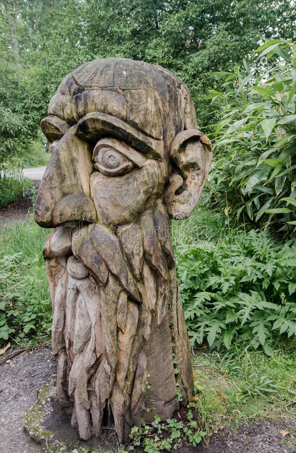 Old wooden sculpture at Mainau island garden royalty free stock images