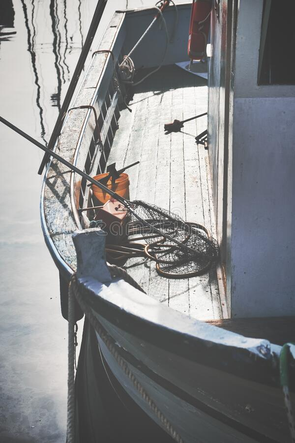 Old wooden shabby fishing boat in the harbor of Trieste. Italy stock photography