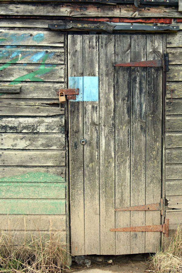 Old wooden shack. An old weathered wooden shack door stock photo