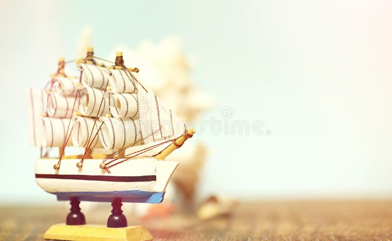 Old wooden ship with sails and masts toy on a stand. Vintage and. Retro toysr royalty free stock photo