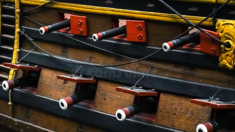 Old wooden ship, side with cannons in Museum of Amsterdam. Close up.  stock image