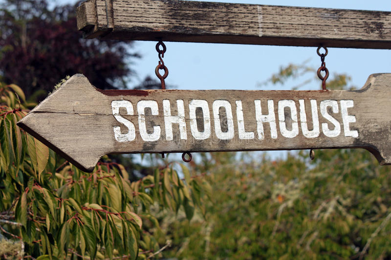 Old Wooden Sign Pointing to School stock photos