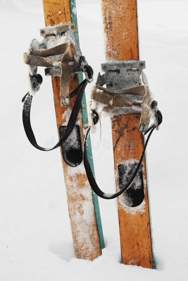 Old wooden skis in the snow royalty free stock image
