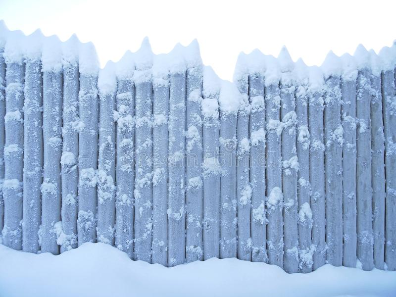Old wooden snow covered wooden board stock image