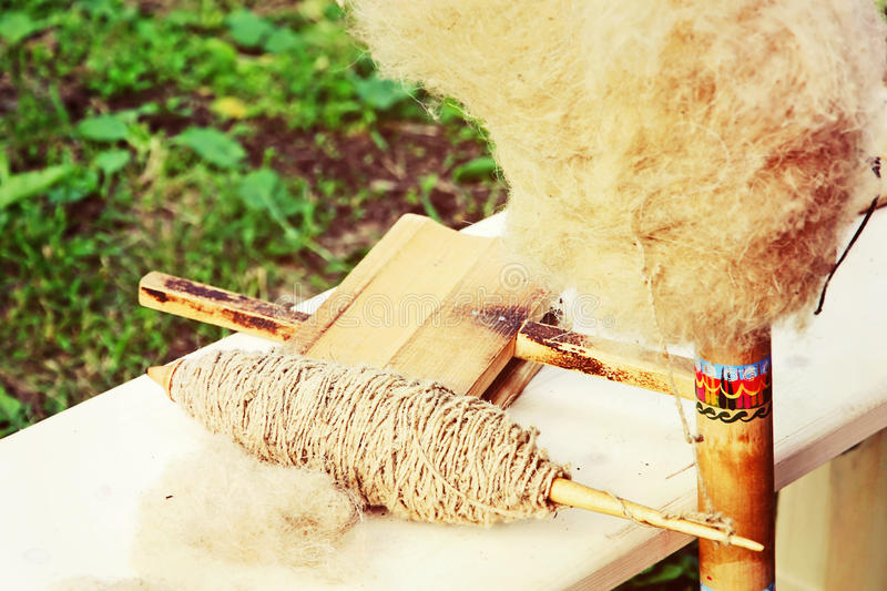 Old wooden spindle. Old wooden spindle taken closeup stock images