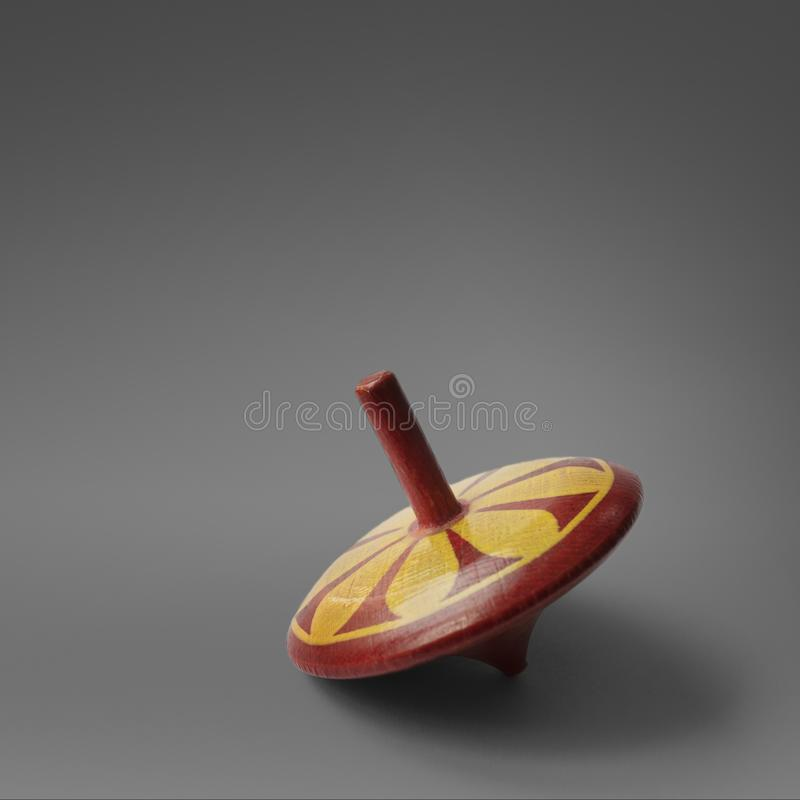 Old wooden spinning top stock image