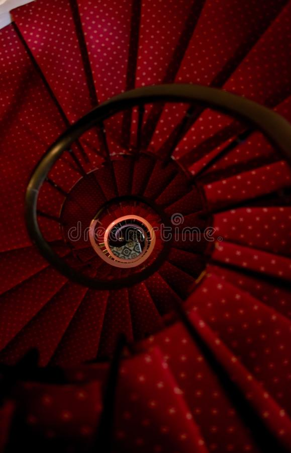 Old spiral red carpet staircase royalty free stock images
