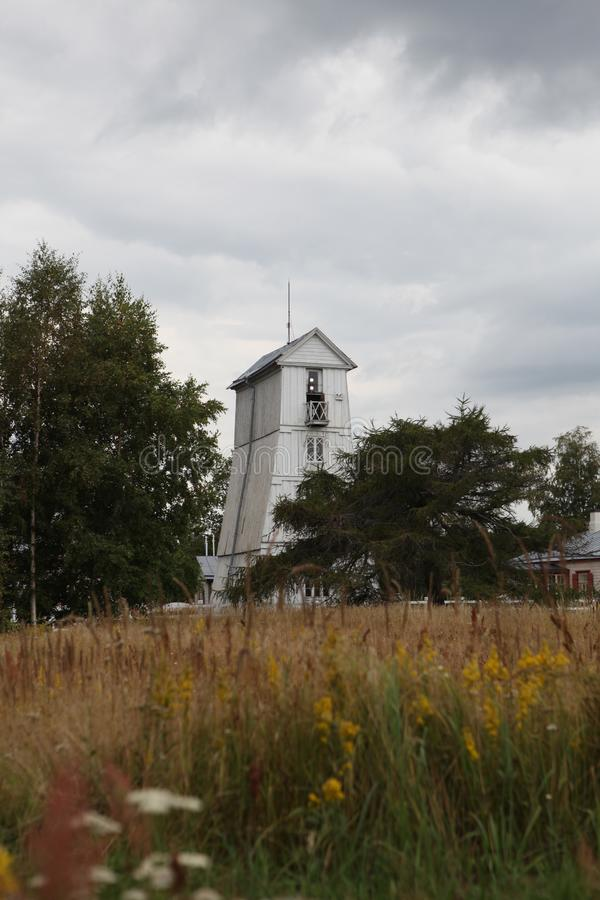 Old wooden square pyramidal front lighthouse in the village Suurupi in Estonia. Suurupi Range Front Lighthouse is built in 1859. White painted A-frame roof stock image