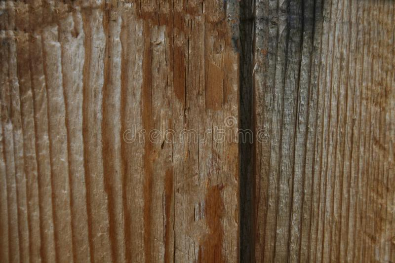 Flaky brown paint on the old wooden surface of the Board stock image