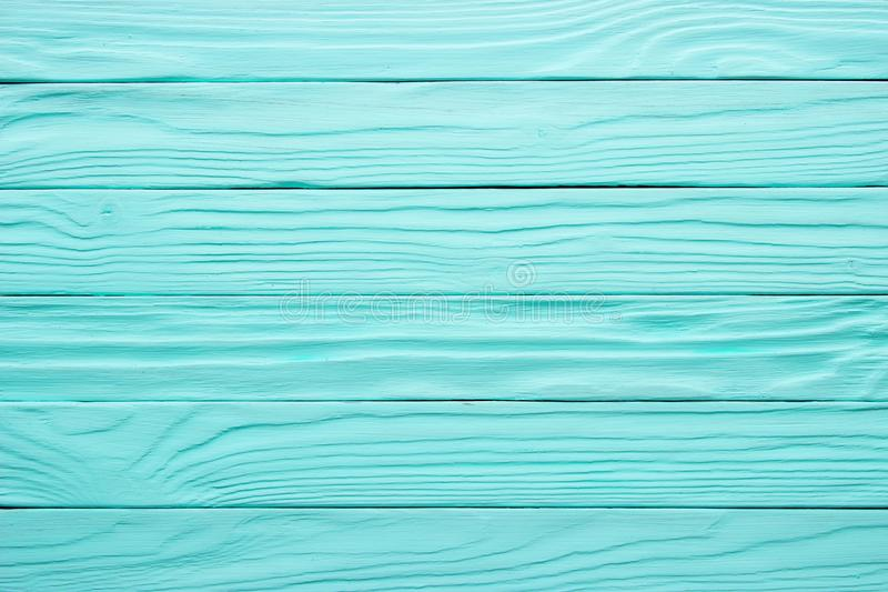 Old wooden table, blue surface of painted wood. Antique texture, background stock image