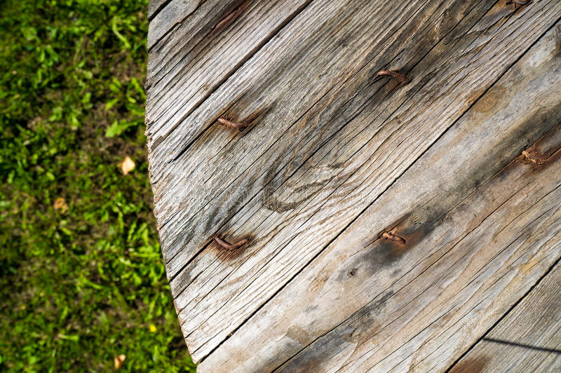 Old wooden table in garden stock images