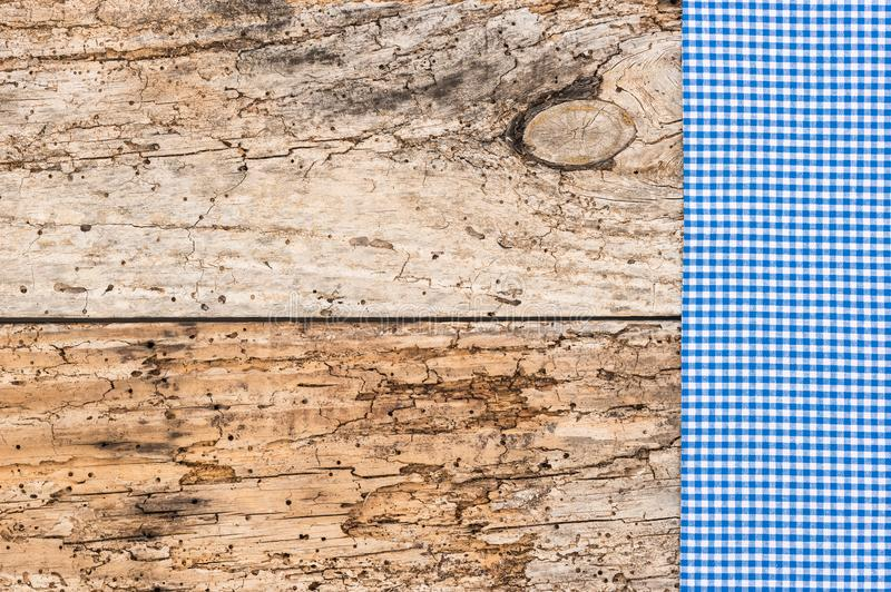 Old wooden texture background with blue checked tablecloth stock images