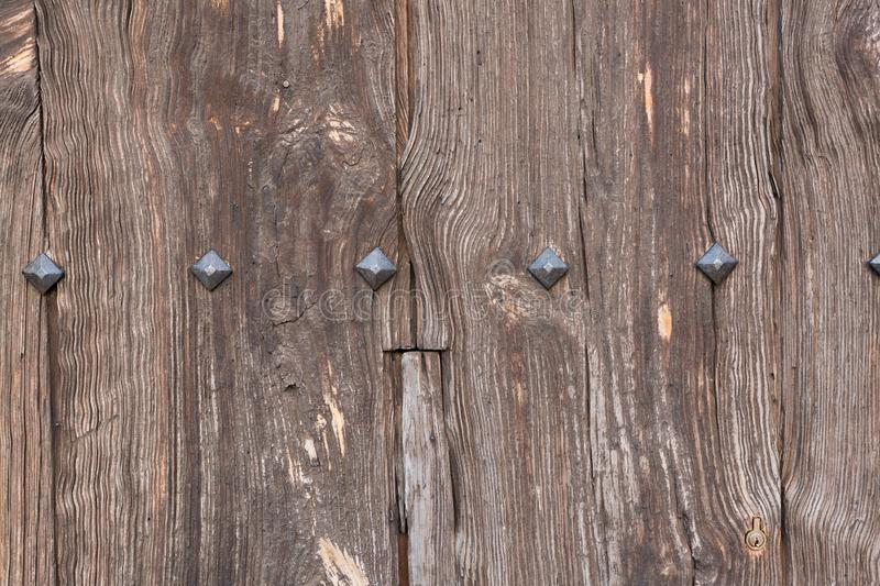Wooden texture with metal rivets. Old wooden texture with metal rivets royalty free stock photo