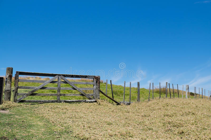Old wooden timber gate and fence in rural New Zealand, NZ royalty free stock photos