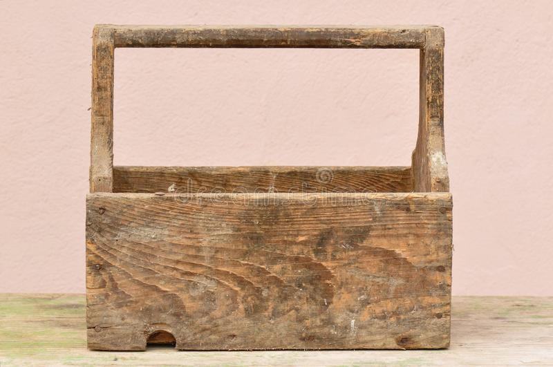 Old Wooden Tool Box. Macro detail of empty old dusty wooden tool box royalty free stock photos