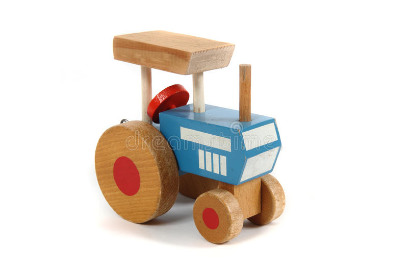 Old wooden tractor toy. Isolated on the white background royalty free stock photo