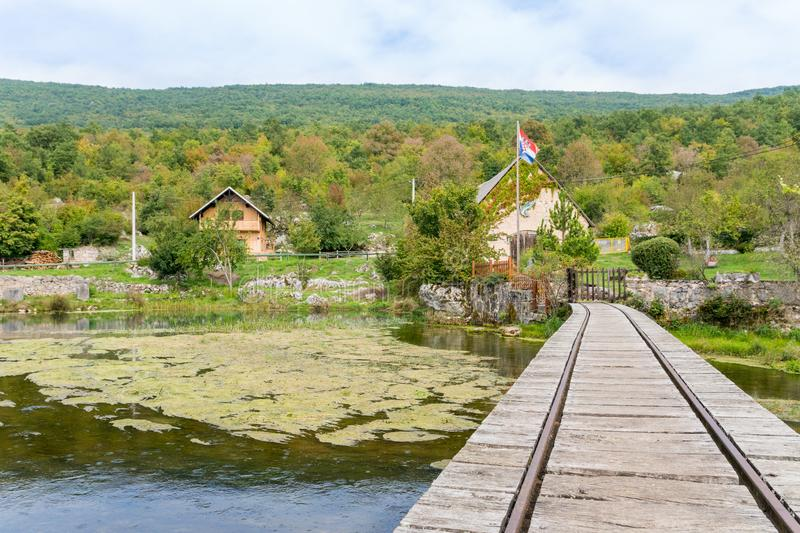 Old wooden train bridge and mill at gacka river in central croatia stock images