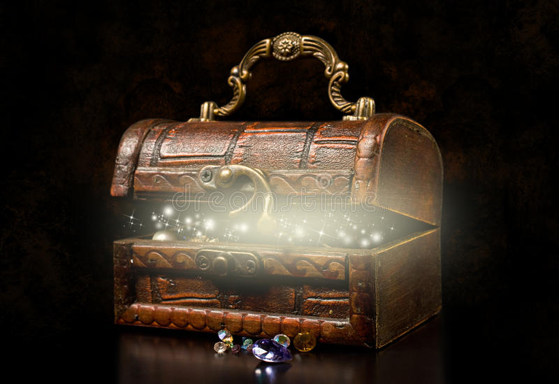 Old wooden treasure chest. On a dark background royalty free stock photography