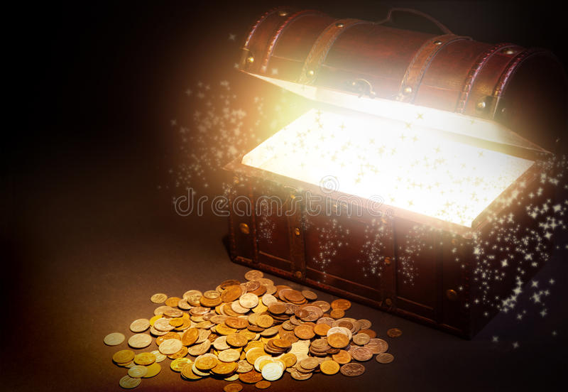 Old wooden treasure chest with gold stock image
