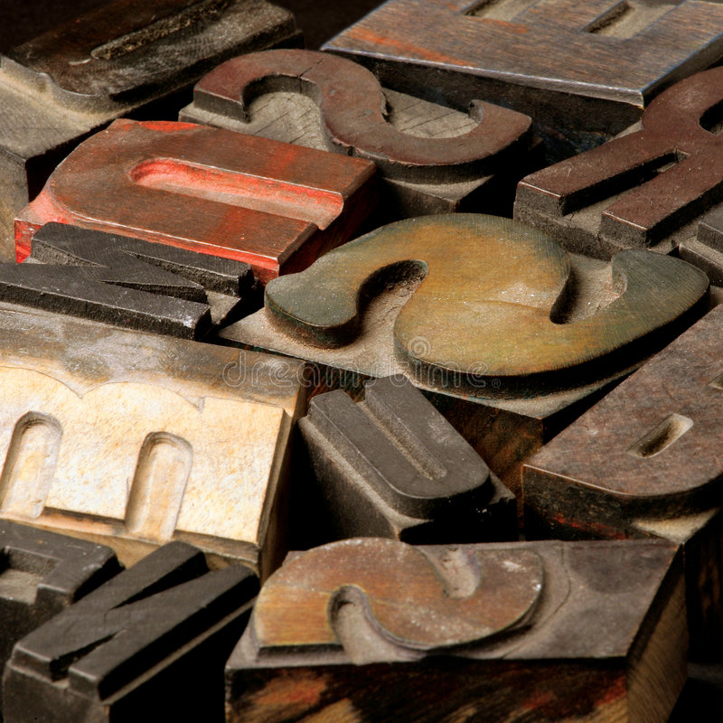 Old wooden type letters. Old wooden printing type. Focus in the middle