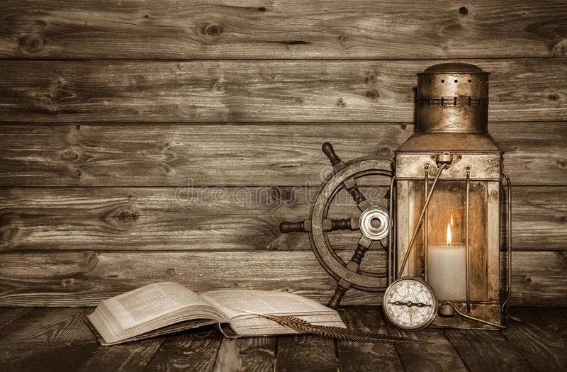 Old wooden vintage background with book, lantern and nautical de royalty free stock images