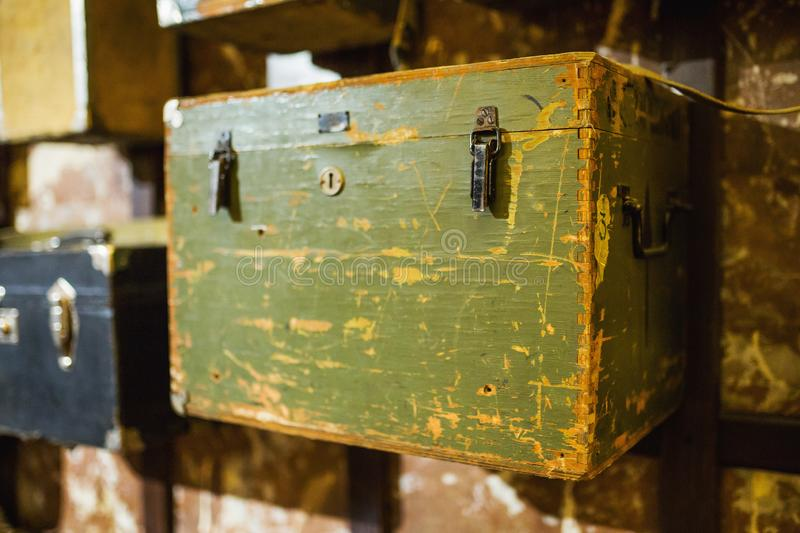 Old wooden vintage chest. Box from wood on wall. Retro safe with lock. Shabby scratched chest. Vintage background. antique wooden stock images