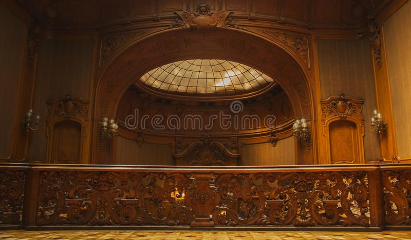 Old wooden vintage railing indoors. luxury carved wood interior in the hall of an aristocratic palace. rare architecture. copy royalty free stock photo