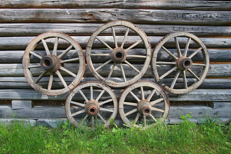 Old wooden wagon wheels stock images