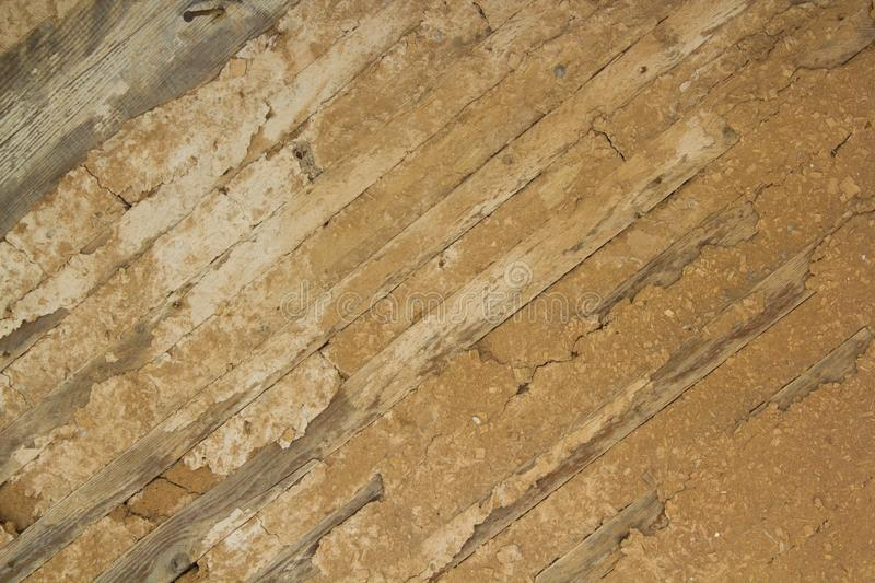 Old wooden wall with insulation made of clay. stock photo