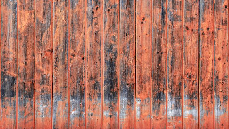 Old wooden wall in Living Coral tone. Trendy pastel. Wooden Background with texture amazing texture and chaotic color pattern stock image