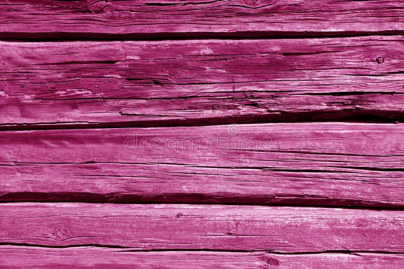 Old wooden wall in pink color. Abstract background and texture for design, vintage, weathered, timber, tree, carpentry, natural, painted, materials, board royalty free stock image
