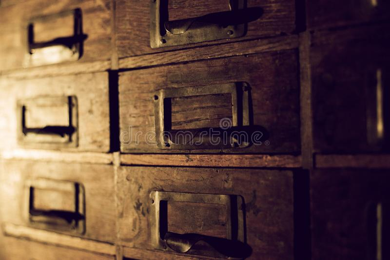 Old wooden wardrobe with small drawers for storing letters, vintage retro-safe, exclusive 19th century handmade mini-wardrobe stock photos