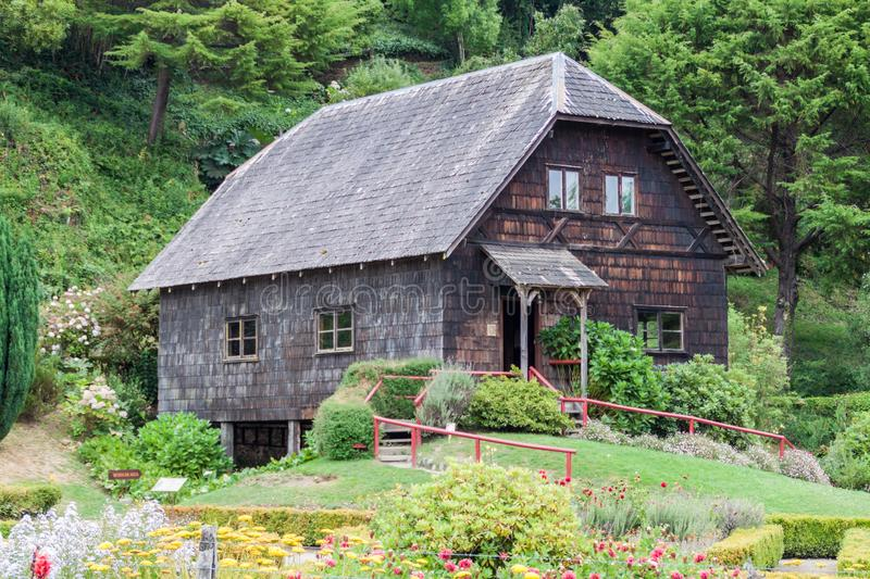Old wooden water mill in Frutillar village, Chi. Le stock image