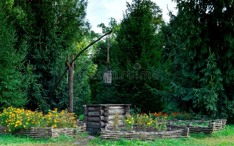 Old wooden well with a bucket royalty free stock images