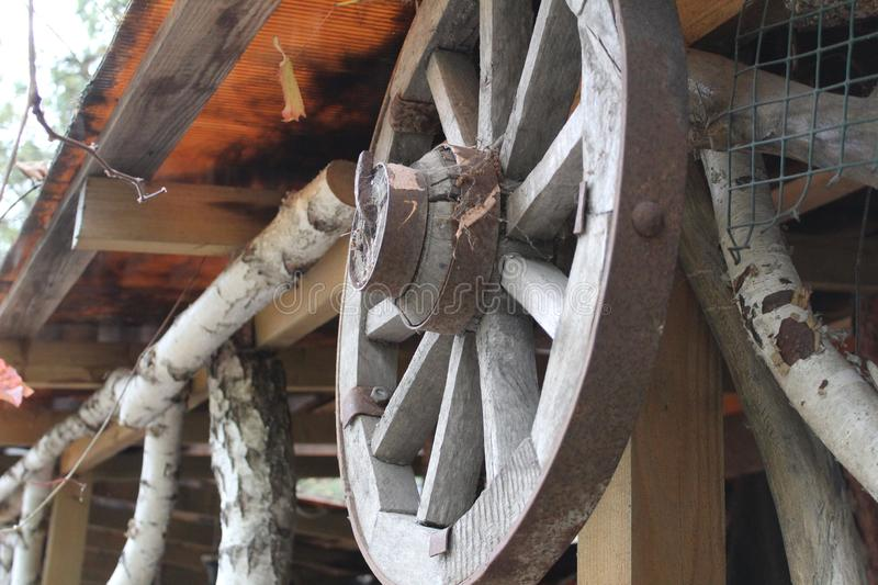 Old, wooden wheel from truck royalty free stock photos