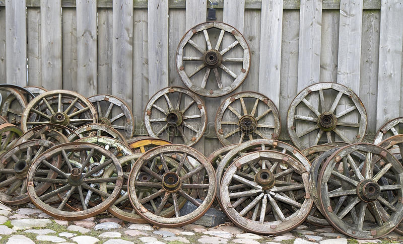 Old wooden wheels from a cart stock images