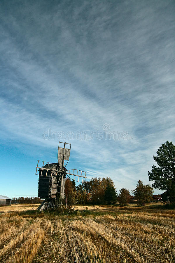 Old wooden windmill. On field on the Hailuoto-island in Finland royalty free stock photo