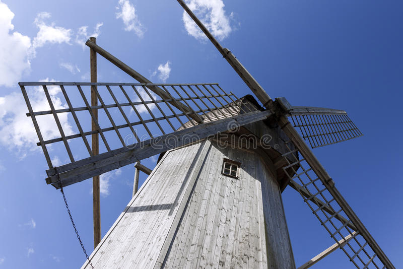 Old wooden windmill. Against blue sky royalty free stock photos