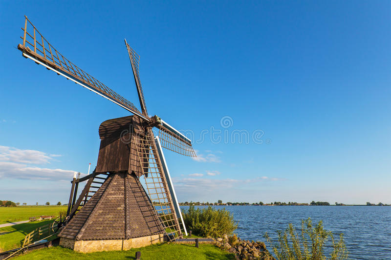 Old wooden windmill in the Dutch province of Friesland royalty free stock image