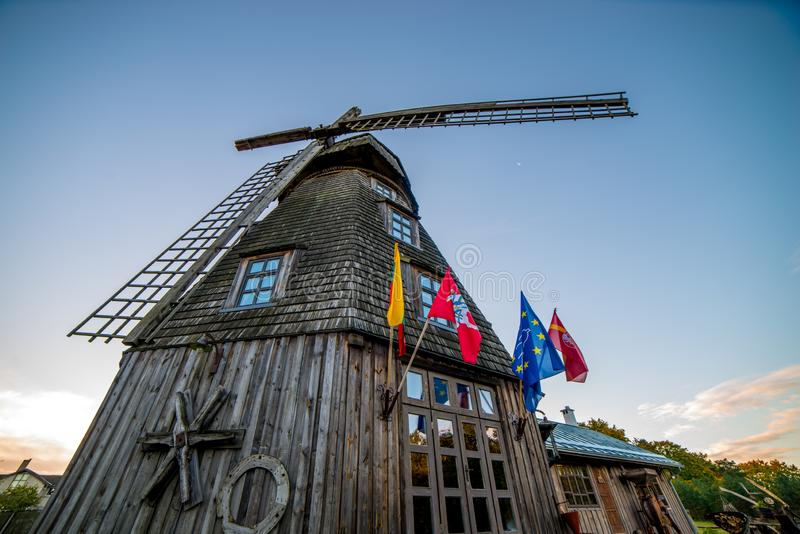 Old wooden windmill in Europe. Old wooden windmill landscape at sunrise fall stock photography