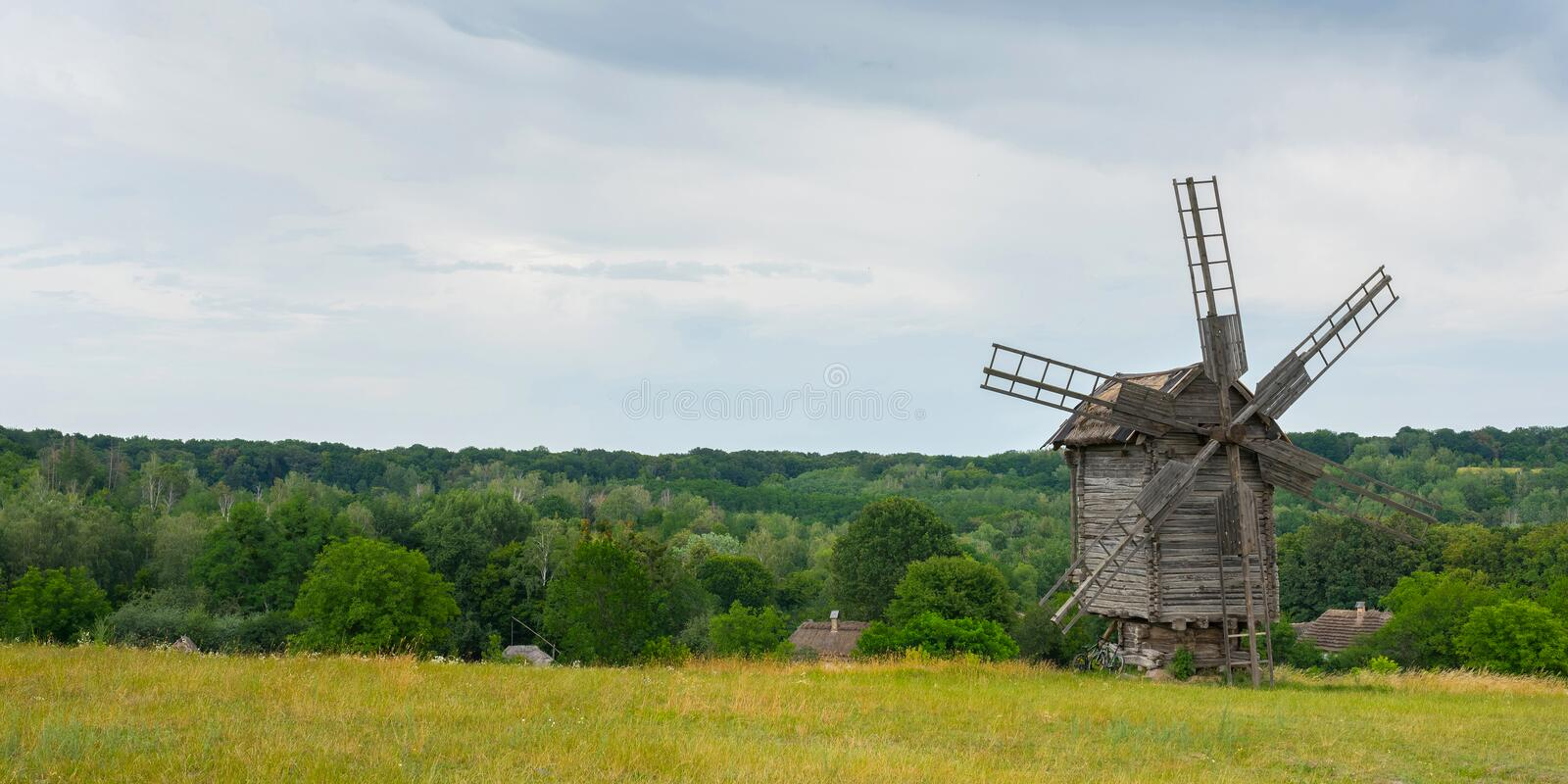Old wooden windmill in the field. Agriculture. Fields and meadows royalty free stock image