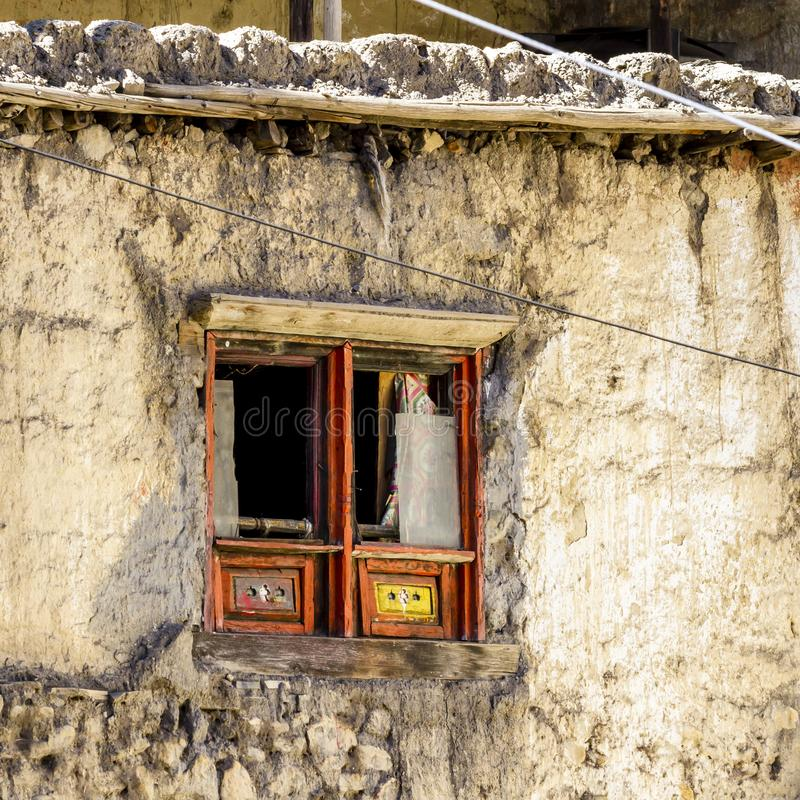 Old wooden window with broken glass in small asian village.  stock photo