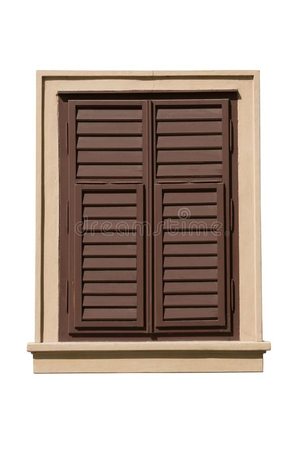Old wooden window closed with brown shutters isolated on white background. Path saved. stock images