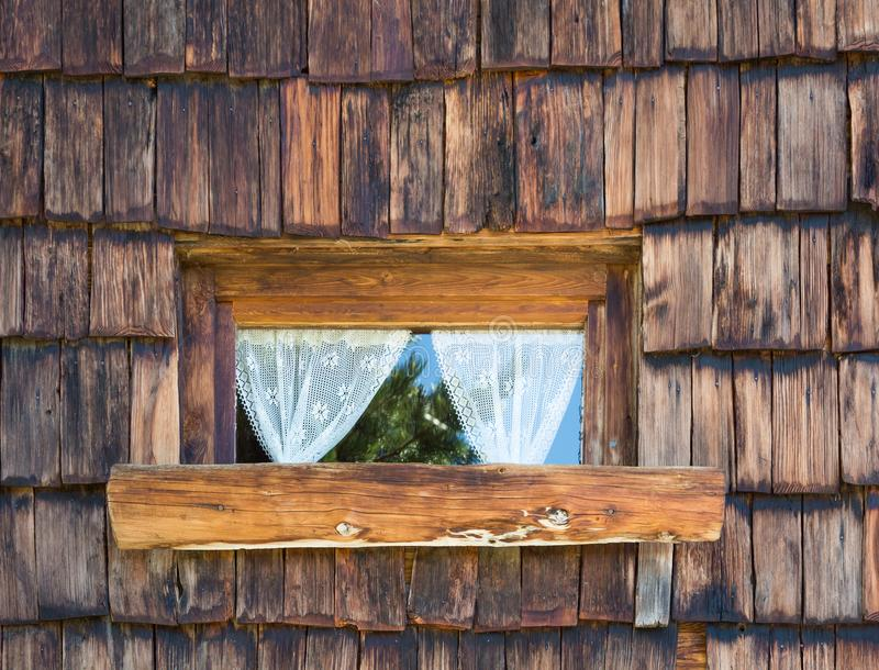 Old wooden window with lace curtains. Windows an wall texture background royalty free stock image